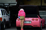 Real Life Barbie with her Pink Corvette