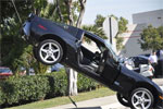 Corvette Lands on Pole Wire After Collision