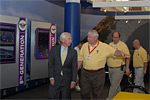 Kentucky Governor Steve Beshear gets a tour of the National Corvette Museum from Executive Director Wendell Strode.