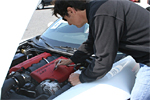 Ron Fellows signing the engine cover of his signature Z06 Corvette