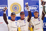 The No. 63 Corvette C6.R team celebrates their 2nd place finish on the podium at Le Mans