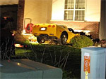 Corvette Crashes into House