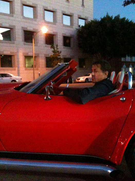 Sly Stallone Cruising in his custom 68 Corvette He Purchased at Barrett-Jackson