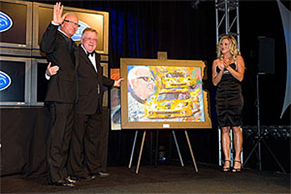Doug Fehan (left) accepts the From the Fans award from ALMS found Don Panoz