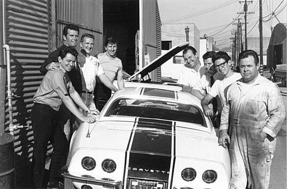James Garner and the AIM Crew around Bob Wingate's aluminum head L89 fire breathing street car.  Photo Credit: www.aiml88.com