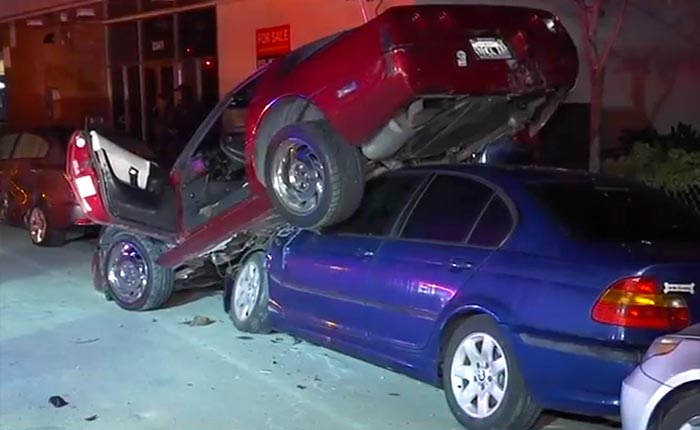 [ACCIDENT] C4 Corvette Driver Crashes Into Parked Cars and Winds Up Stuck On Top a BMW