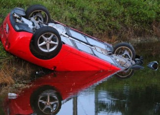 [ACCIDENT] Hertz Corvette Rental Lands Upside Down in a South Florida Canal